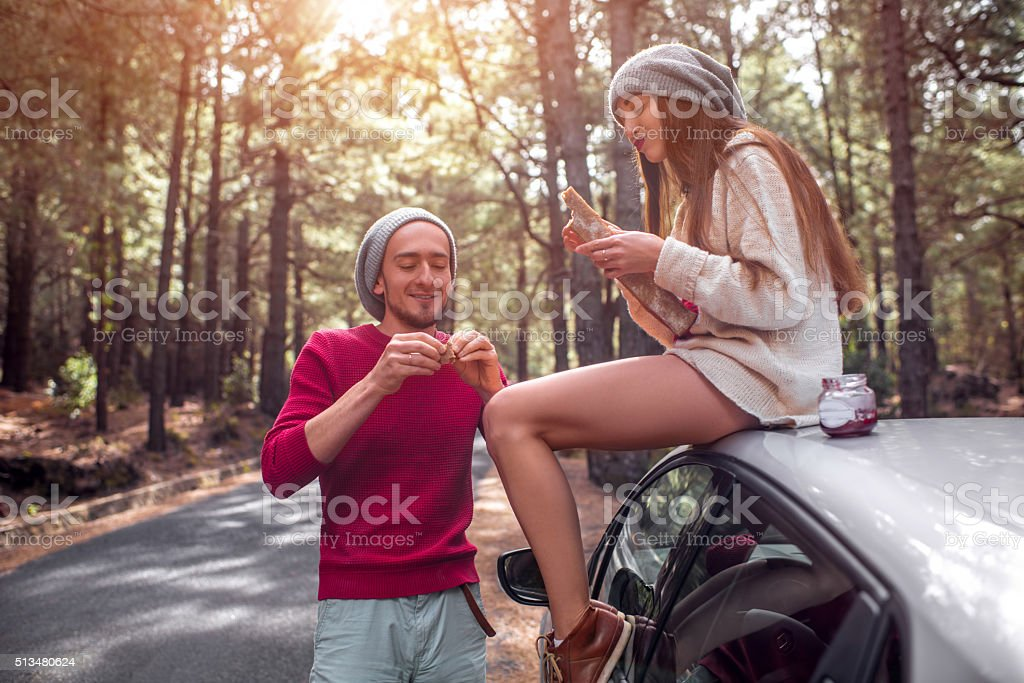 Young couple traveling by car in the forest stock photo