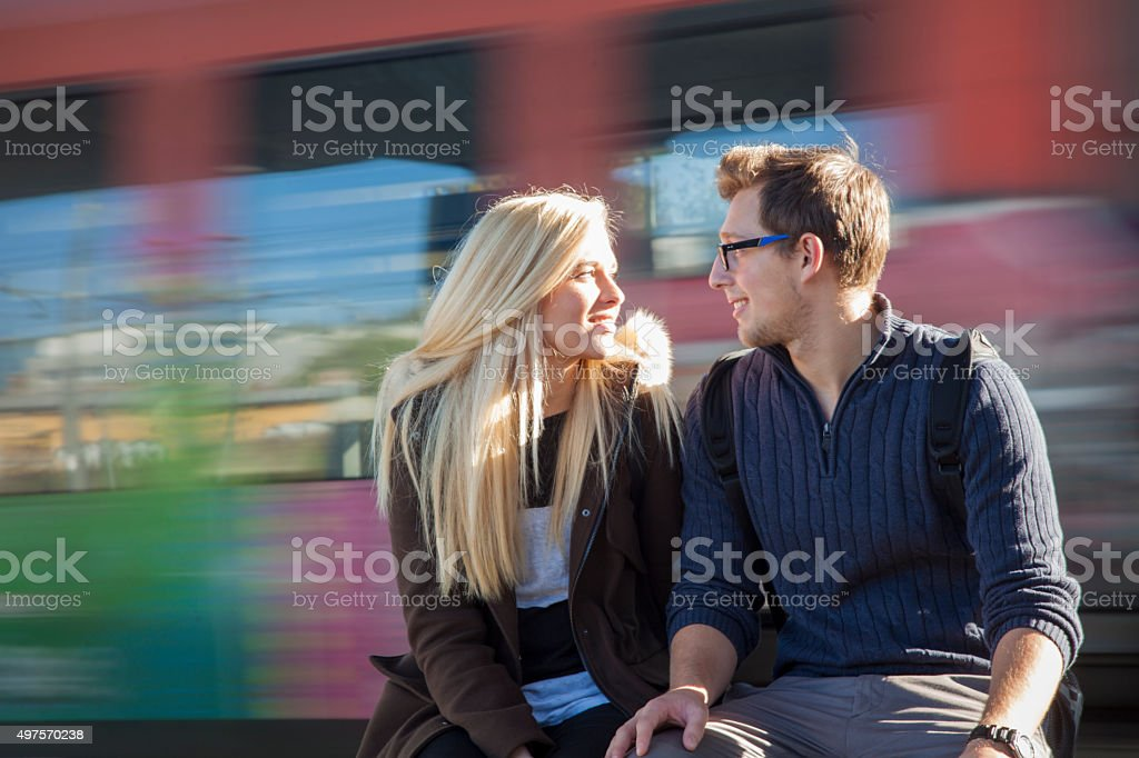 Young couple traveling by train stock photo
