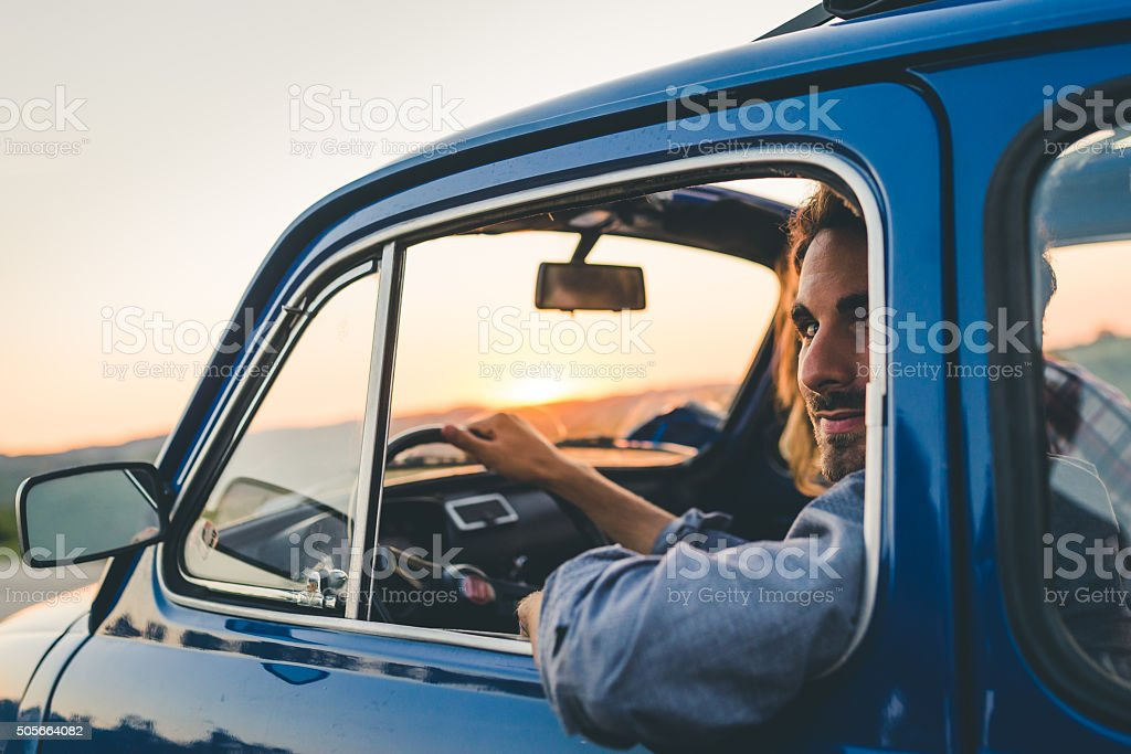 Young Couple Trip With Vintage Car stock photo