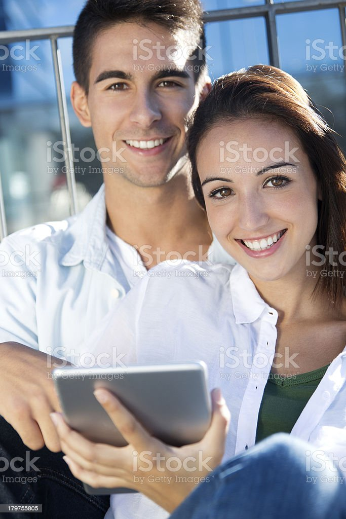young couple using a digital tablet royalty-free stock photo