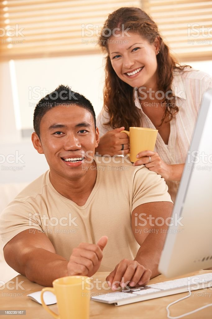 Young couple using computer royalty-free stock photo