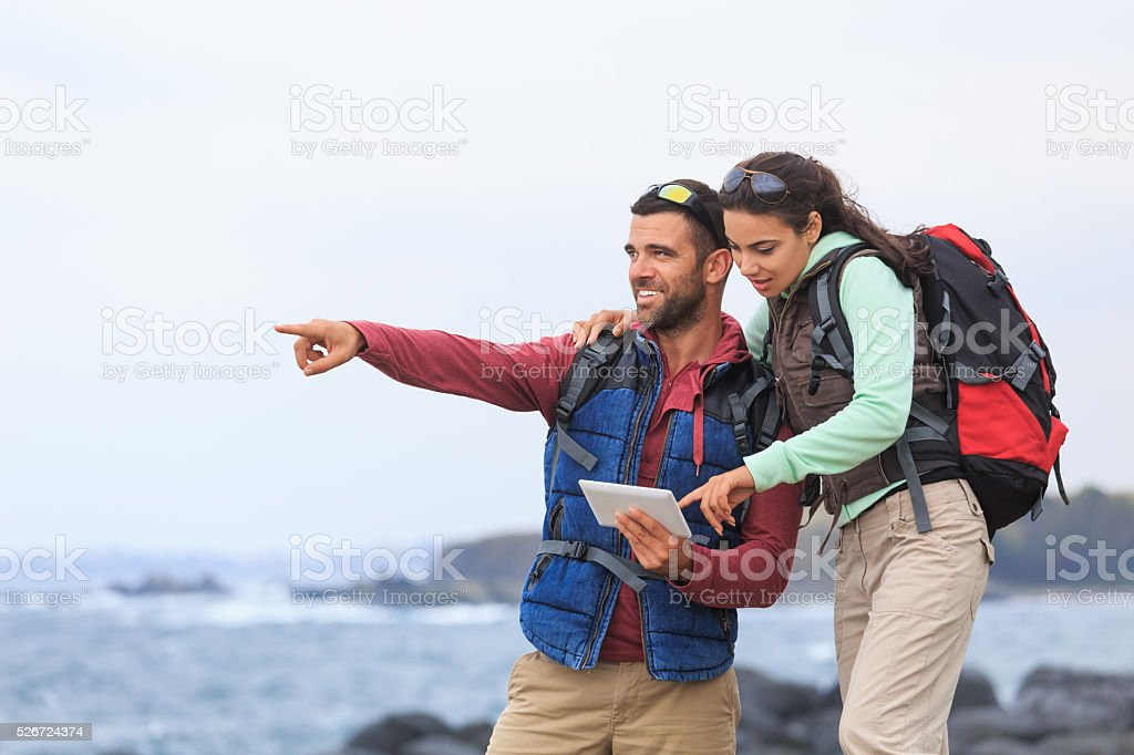 Young couple using digital tablet for navigation stock photo