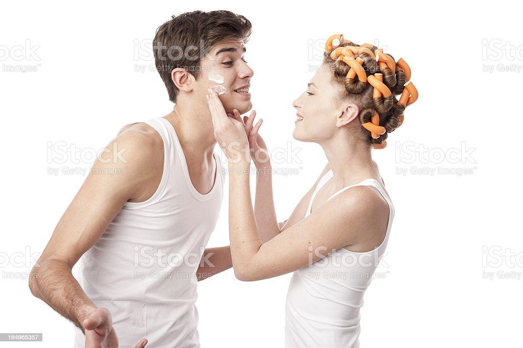 young couple using facial cream royalty-free stock photo