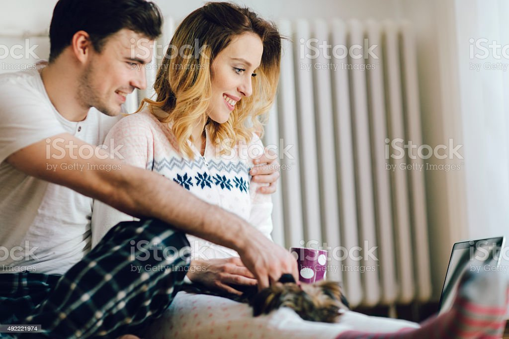 Young Couple Using Laptop In Living Room. stock photo