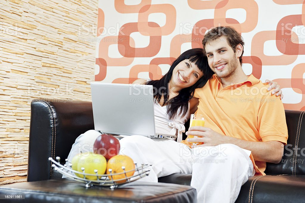 Young couple using laptop royalty-free stock photo
