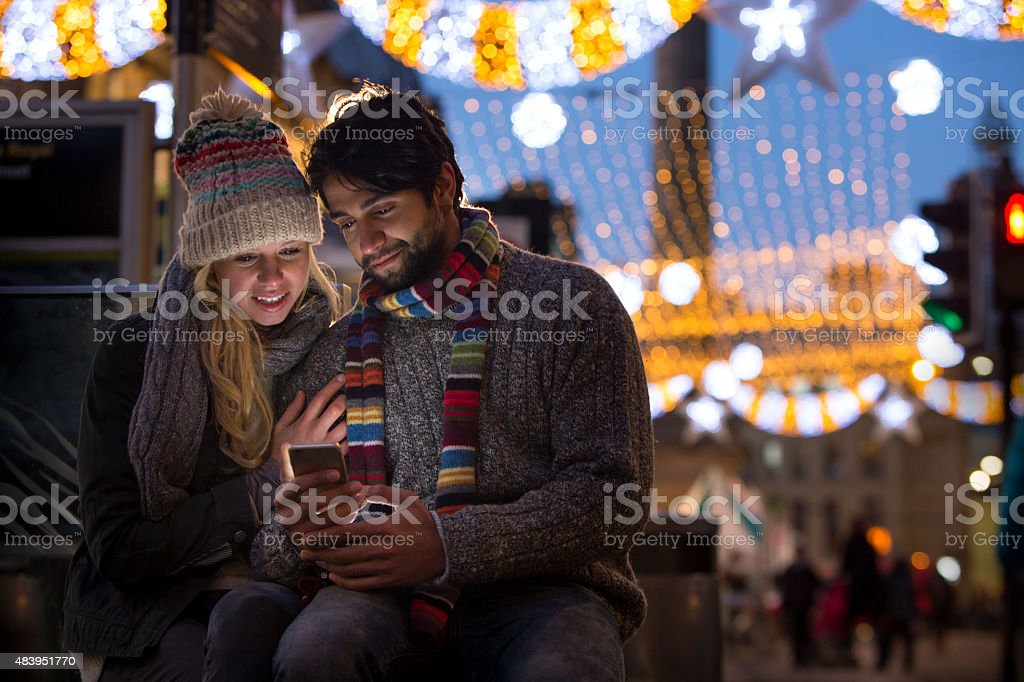 Young Couple using Smart Phone stock photo