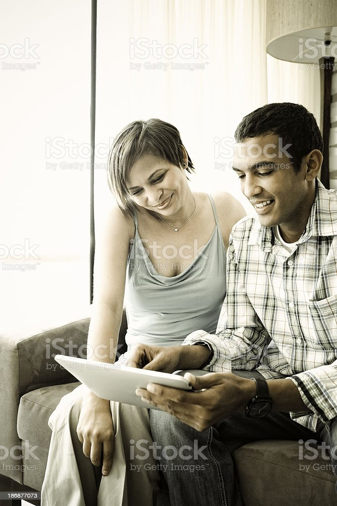 Young Couple Using Tablet Computer stock photo