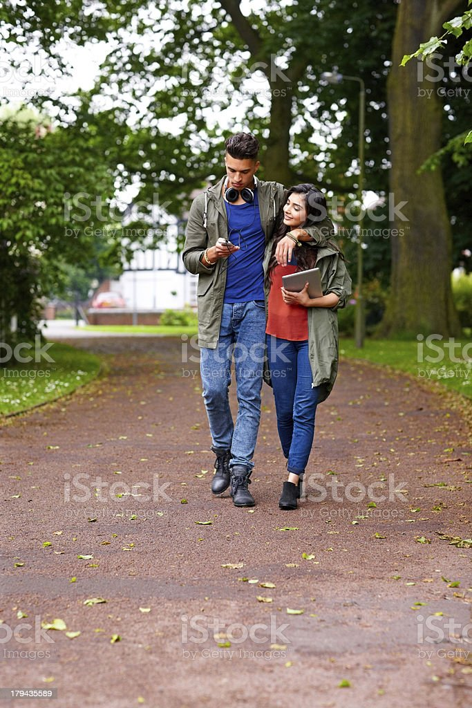 Young couple using technology outdoors royalty-free stock photo