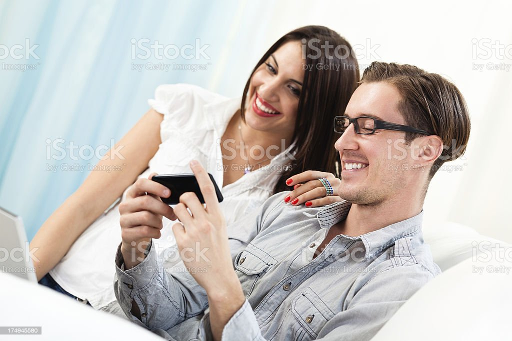Young couple using technology royalty-free stock photo
