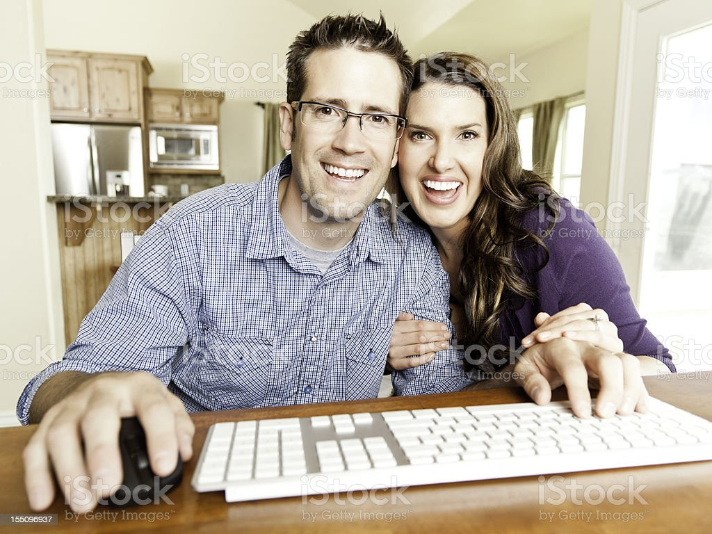 Young Couple Using Webcam / Internet stock photo