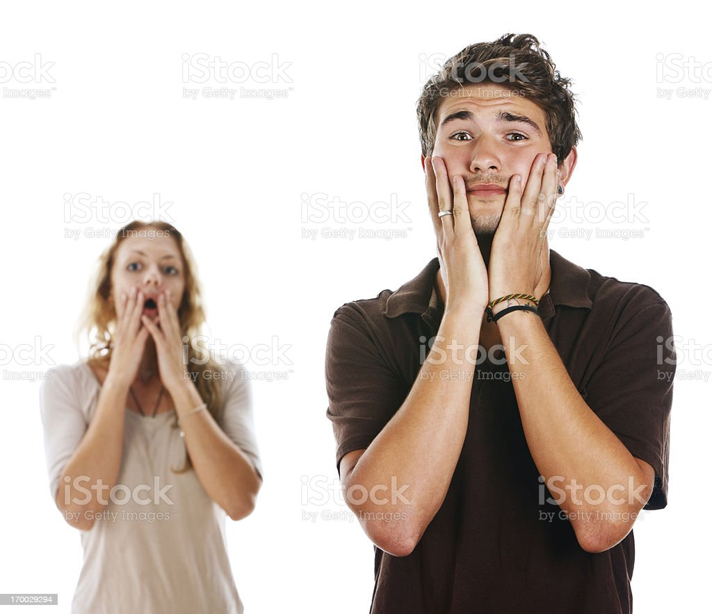 Young couple very upset by something just seen or heard stock photo