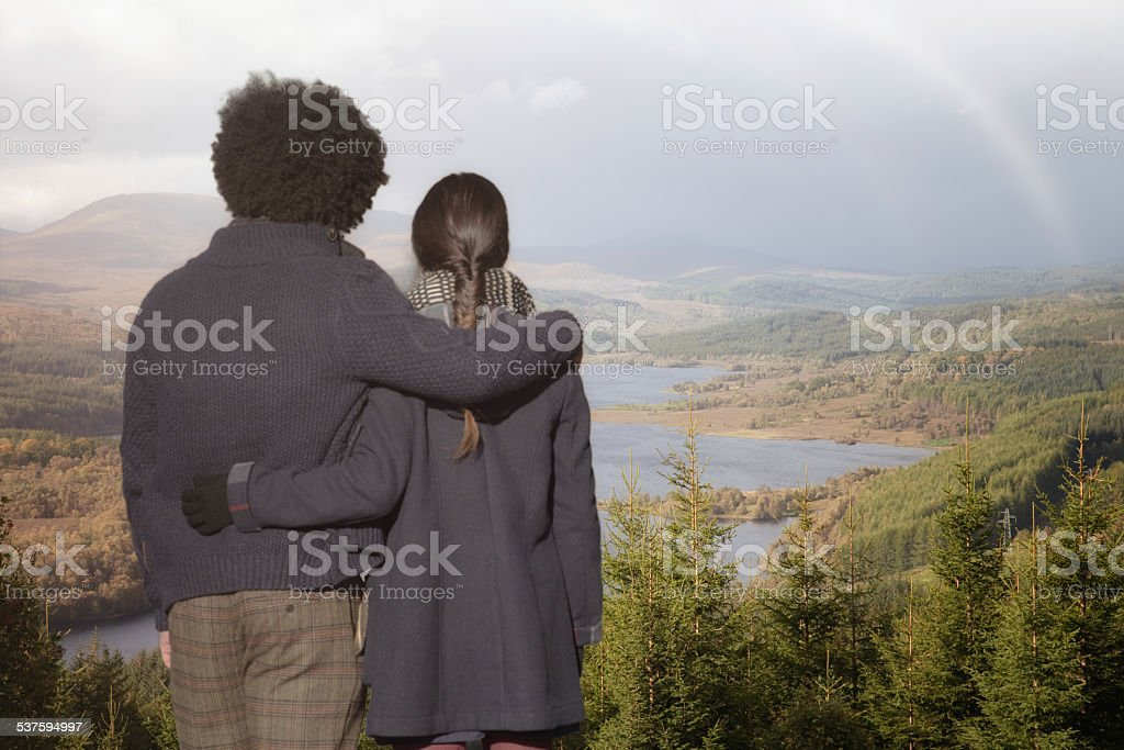Young couple visiting Scotland looking at gorgeous view Loch Garry stock photo