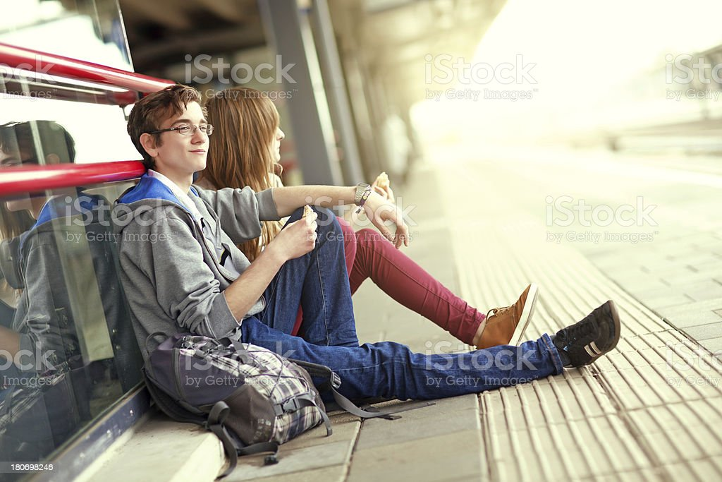 young couple waiting for the train royalty-free stock photo