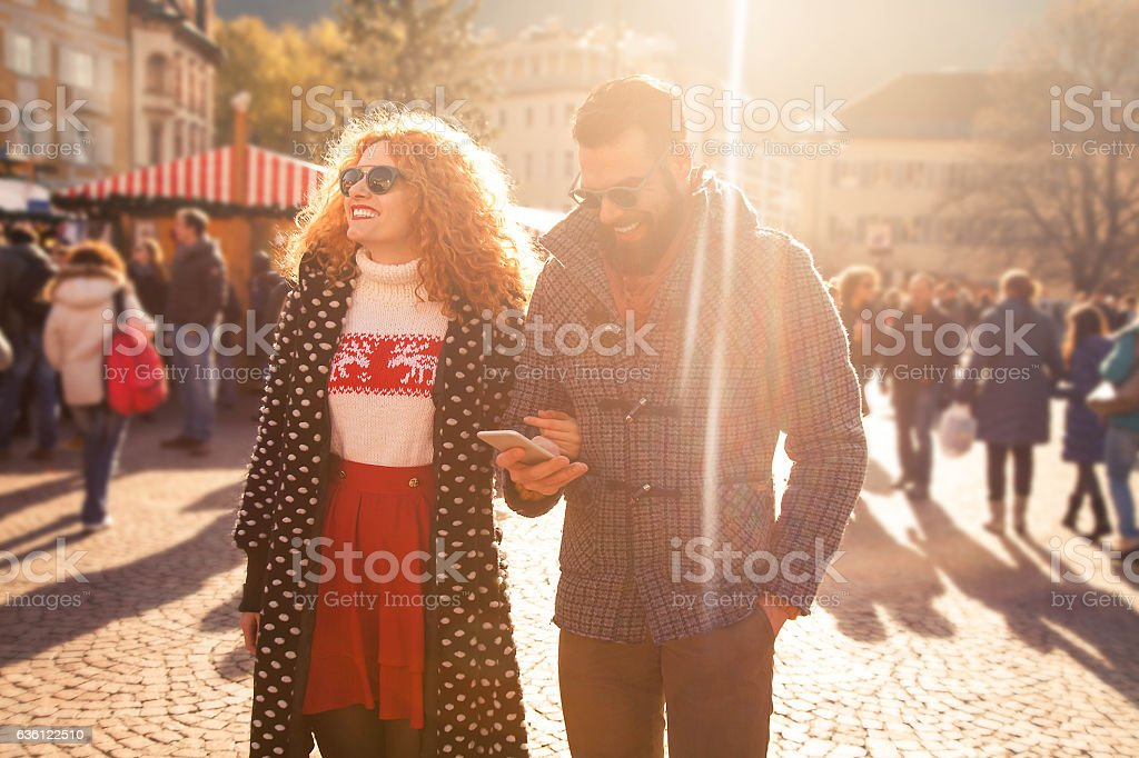 Young couple walk in the city during winter stock photo