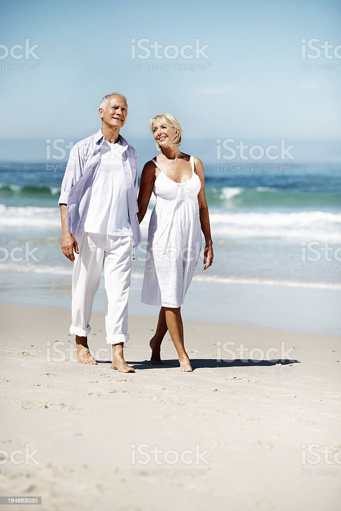Young couple walking along the beach royalty-free stock photo