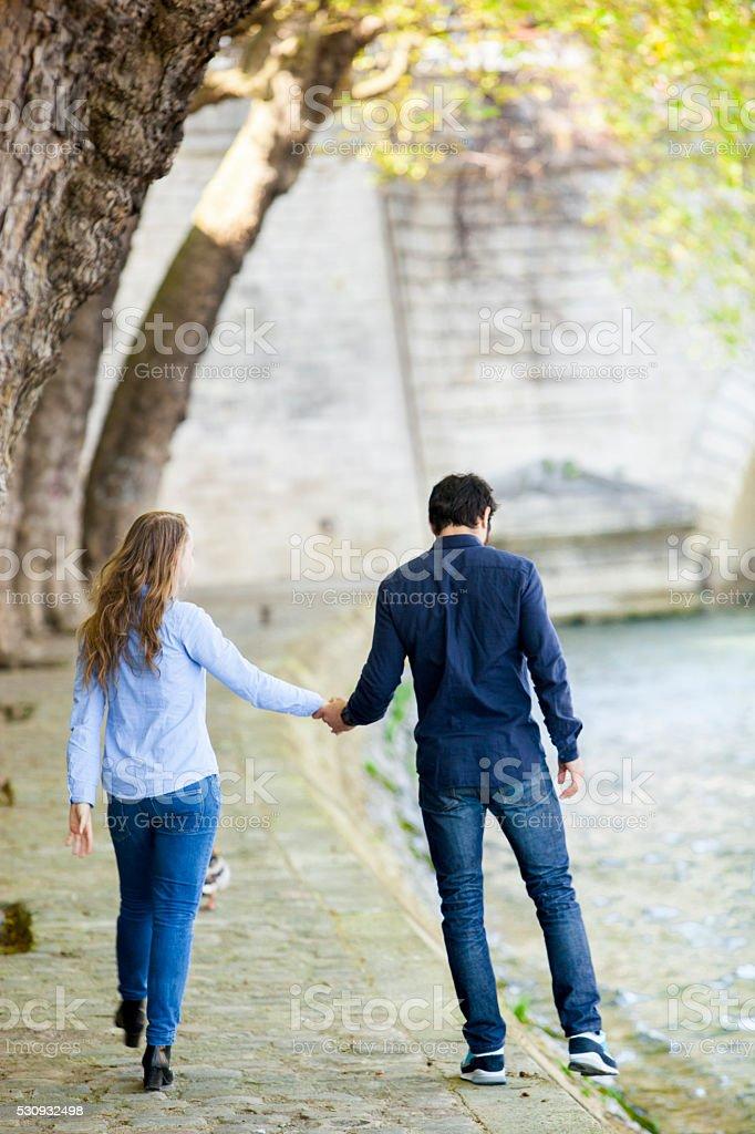 Young Couple Walking At A Riverbank stock photo