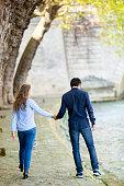 Young Couple Walking At A Riverbank