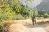 Young couple walking down nature trail.