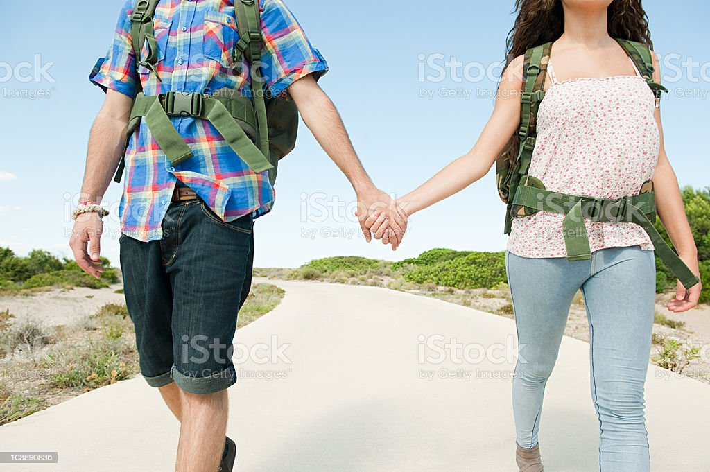 Young couple walking down rural road royalty-free stock photo