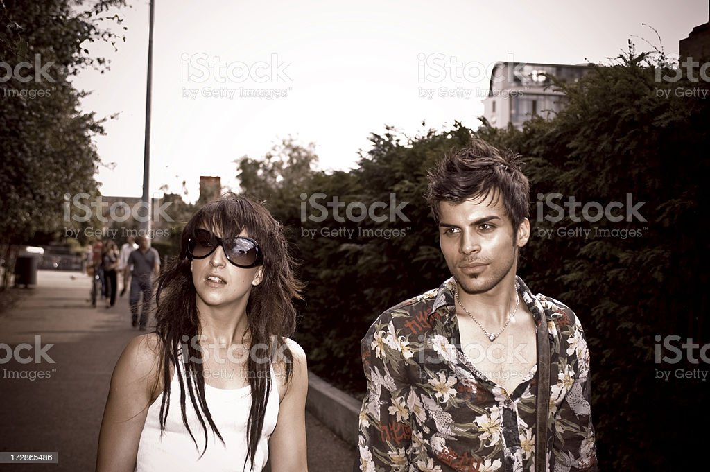 Young Couple walking down the Street stock photo