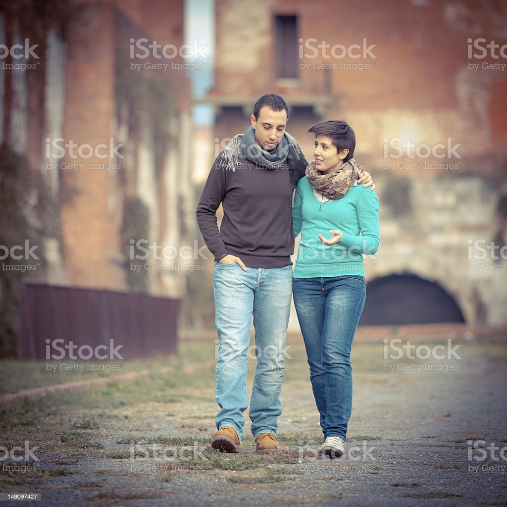 Young Couple Walking Embraced royalty-free stock photo