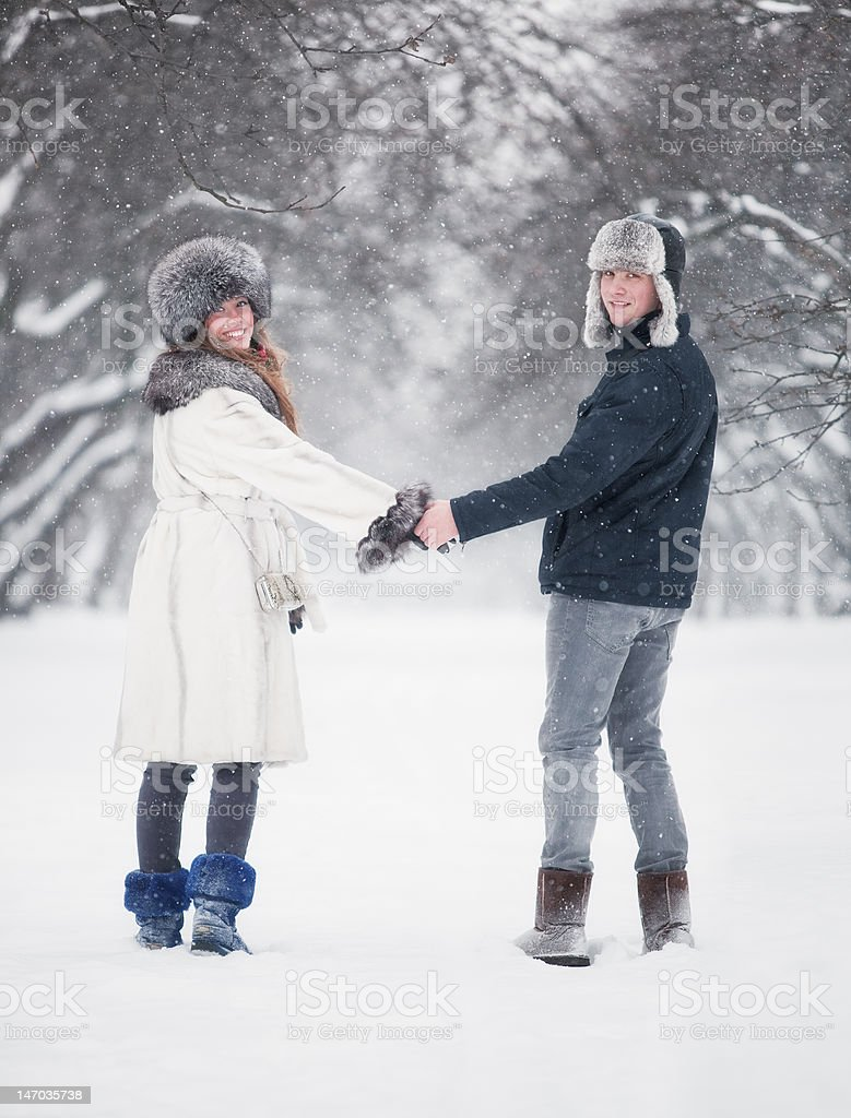 Young couple walking in a park royalty-free stock photo