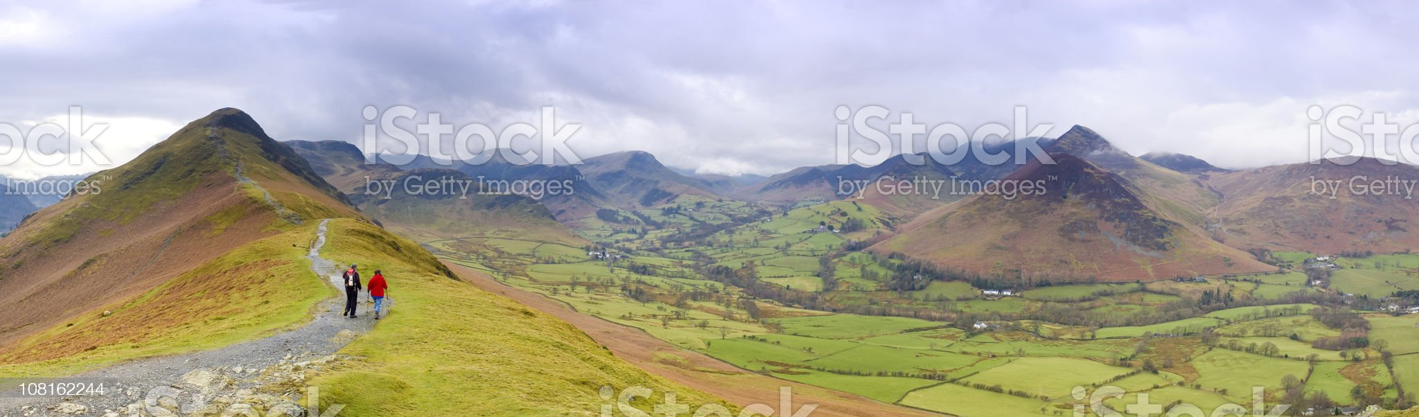 Young Couple Walking in Mountains royalty-free stock photo