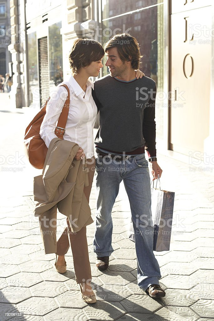 Young couple walking in street royalty-free stock photo