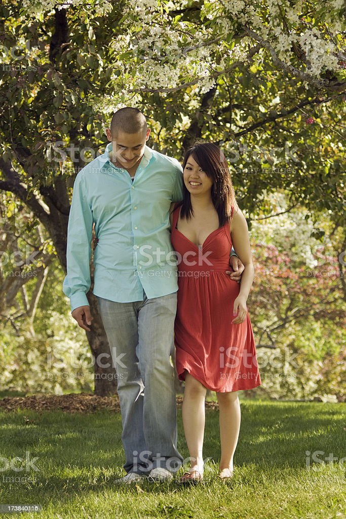 Young Couple Walking in the Park royalty-free stock photo