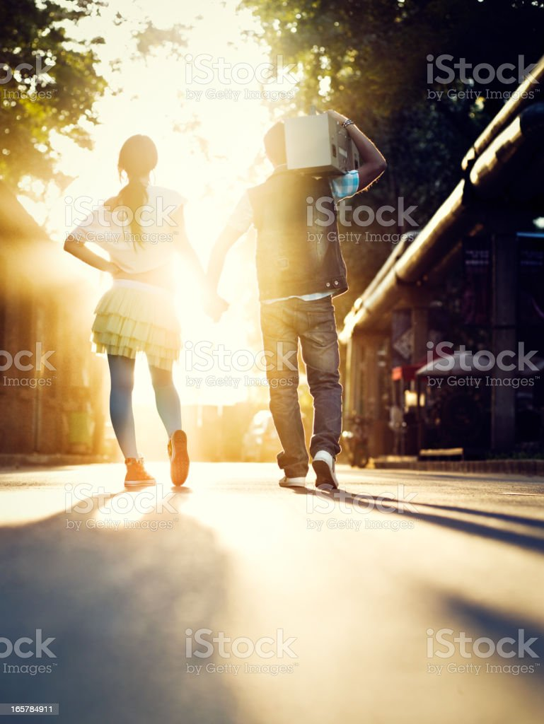 Young couple  walking in the sunrays stock photo