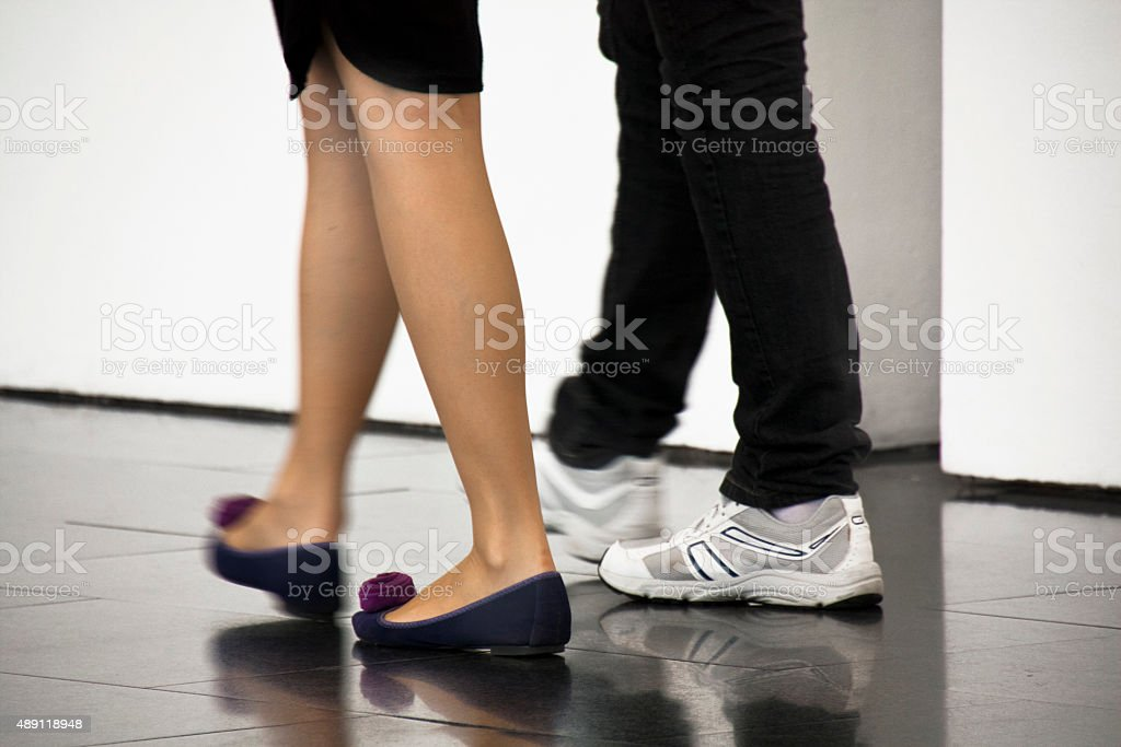 Young couple walking indoors. stock photo