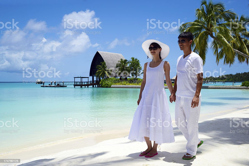 Young Couple Walking On Beach royalty-free stock photo