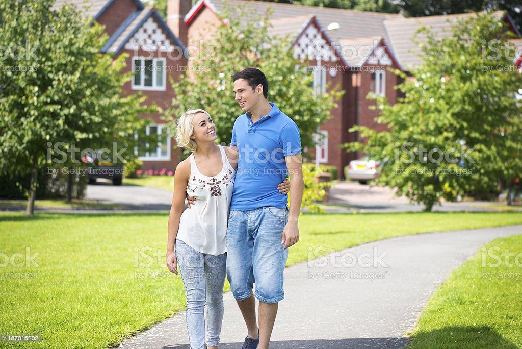 young couple walking through housing development royalty-free stock photo