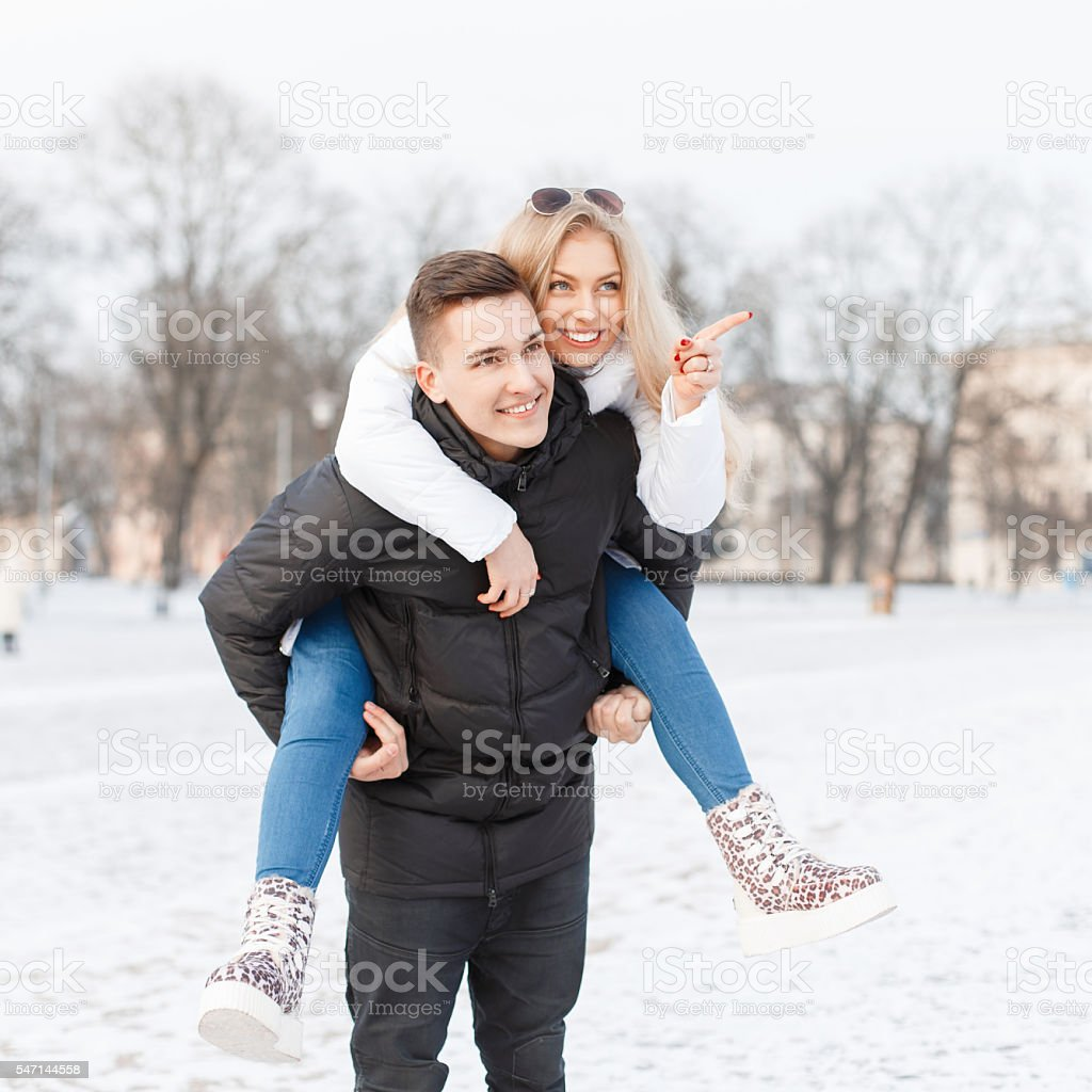Young couple walking through the city. stock photo