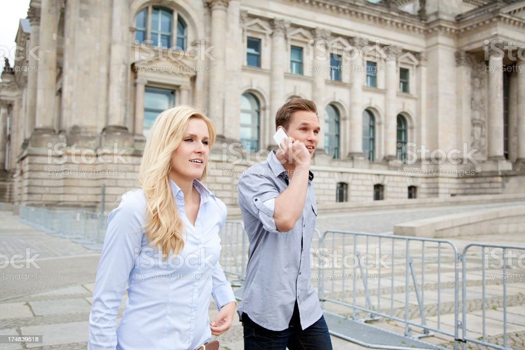 Young couple walking with boy talking on the phone royalty-free stock photo