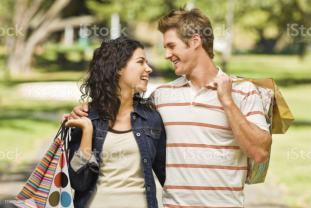 Young couple walking with shopping bags royalty-free stock photo