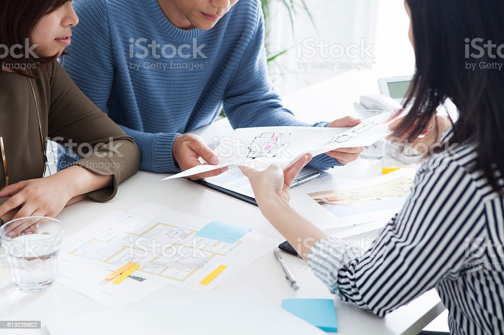 Young couple want to buy a house. stock photo
