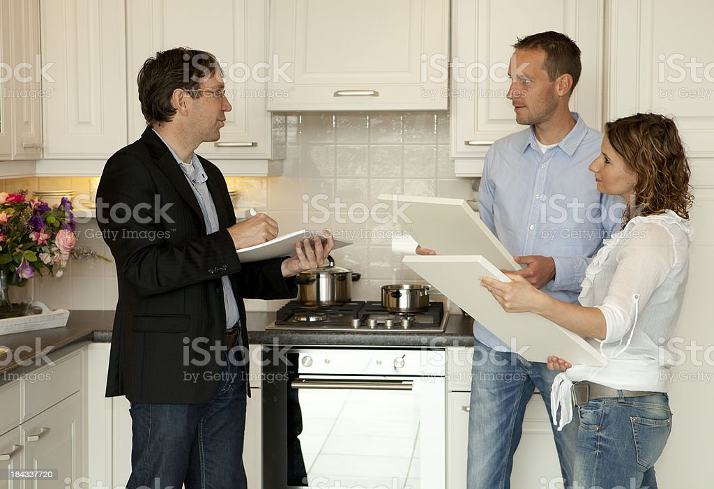 Young couple wants to buy a new kitchen in store. royalty-free stock photo