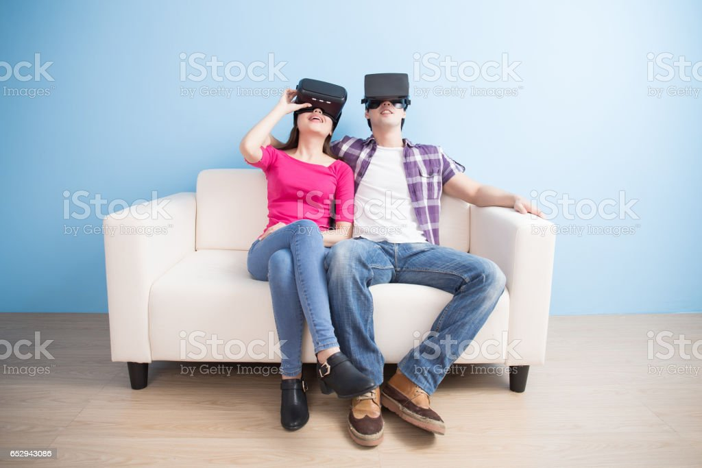 young couple watch vr game stock photo