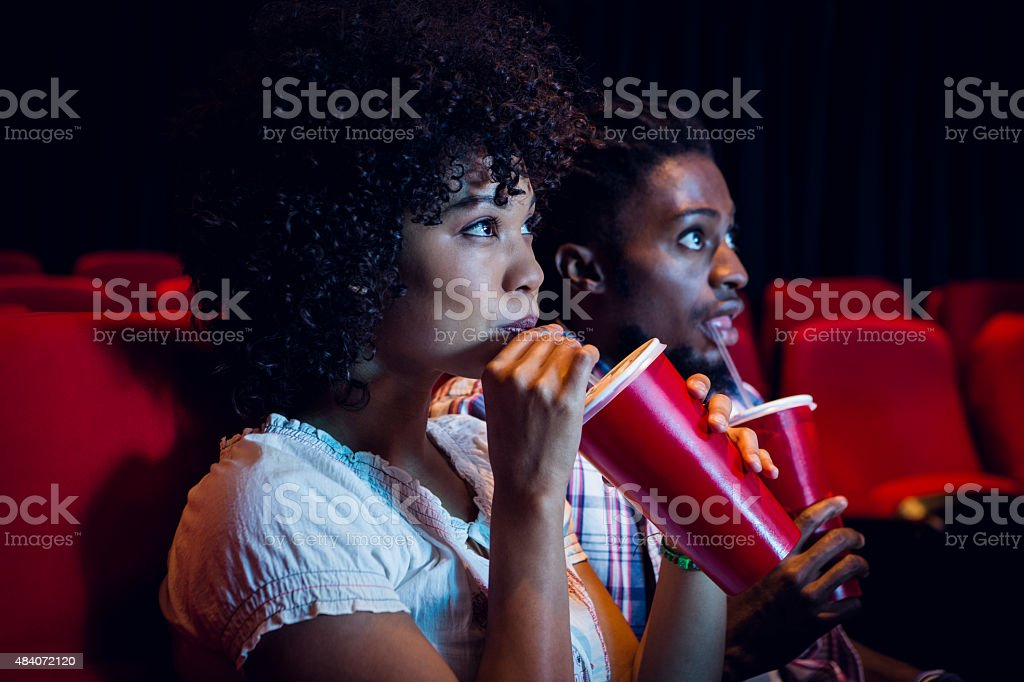 Young couple watching a film stock photo