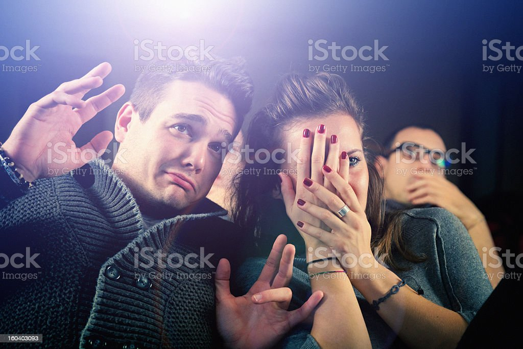 Young couple watching a movie at the cinema royalty-free stock photo