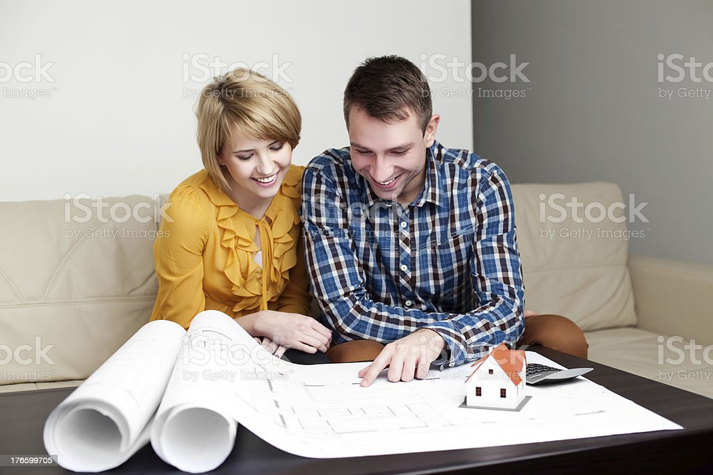 Young couple watching home project royalty-free stock photo