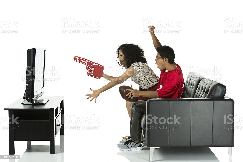 Young couple watching television royalty-free stock photo