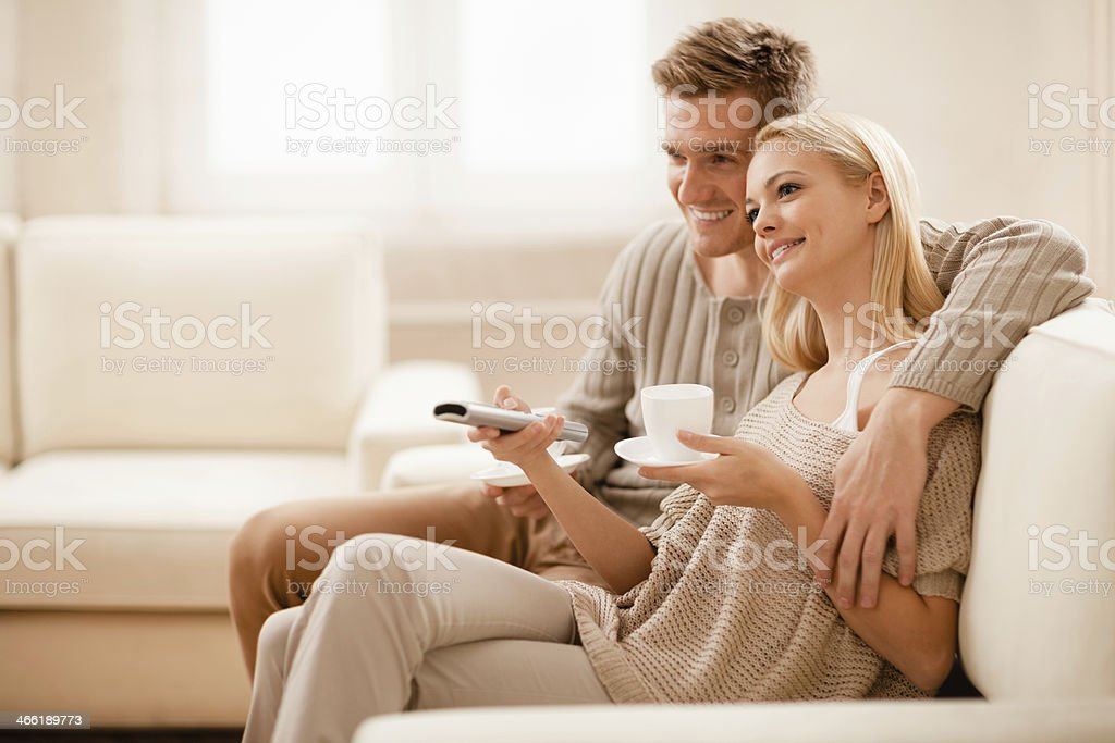 Young couple watching television together royalty-free stock photo