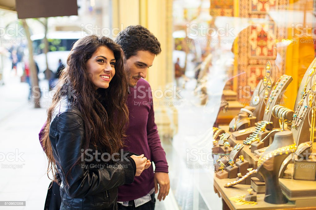 Young Couple Window Shopping at a Jewelry Shop stock photo