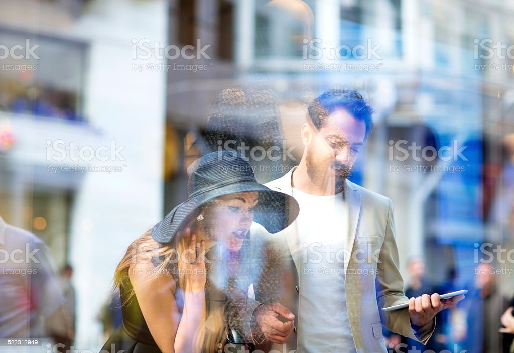 young couple window shopping in the city stock photo