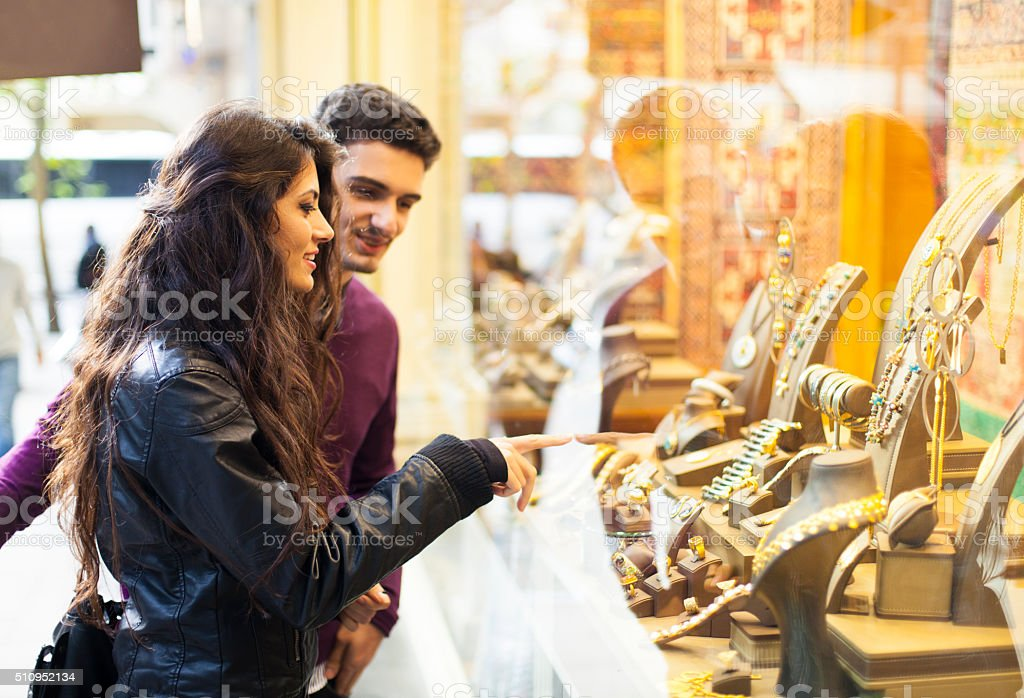 Young Couple Window Shopping in the Street stock photo