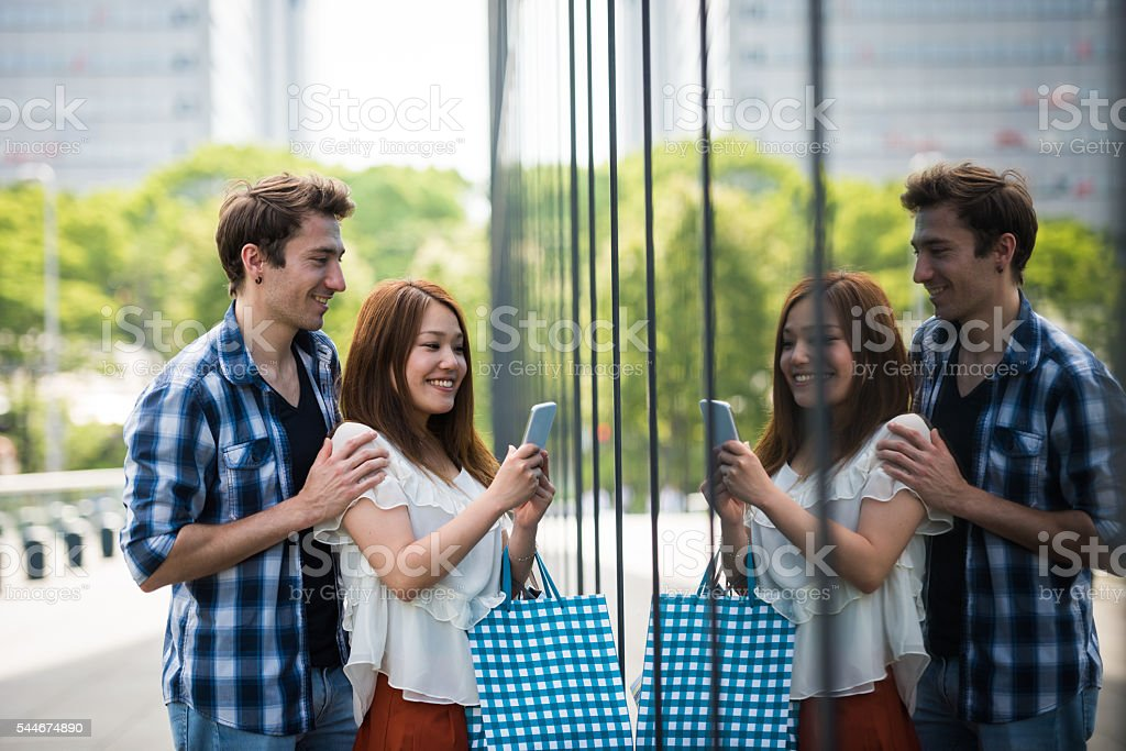 Young couple window shopping stock photo