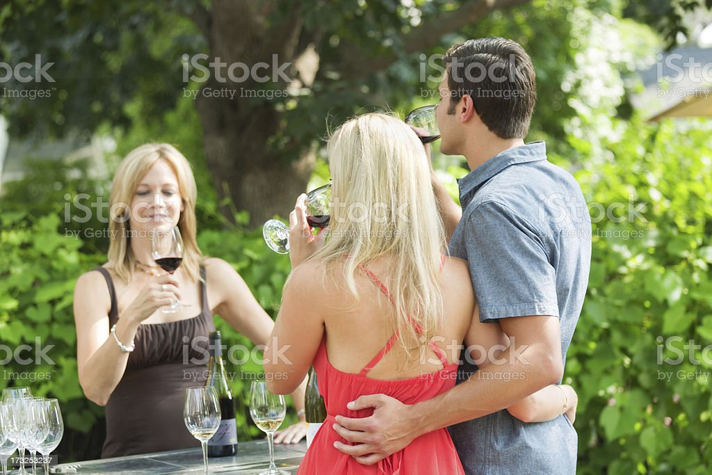 Young Couple Wine Tasting in Winery Vineyard royalty-free stock photo