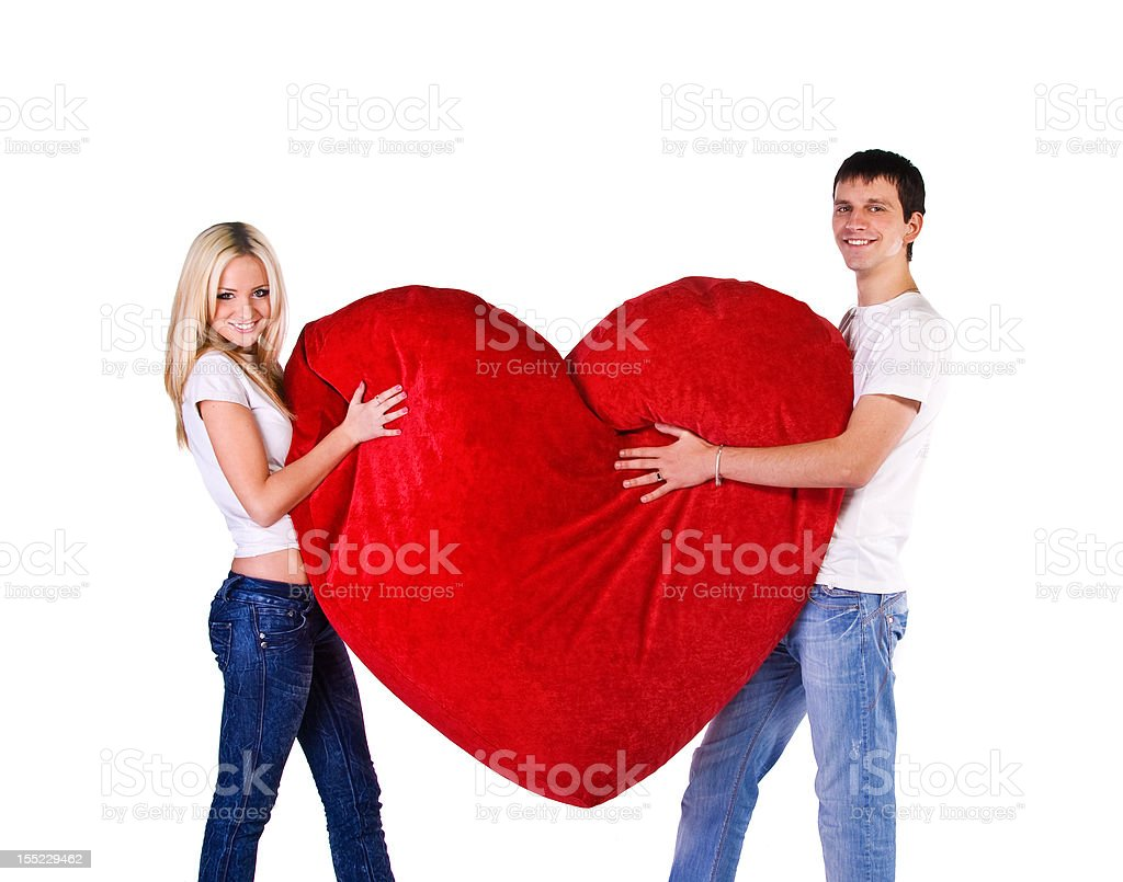 Young couple with a big heart royalty-free stock photo